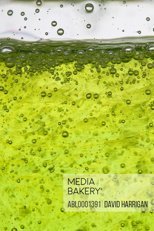Close up of bubbly lime green dishwashing detergent