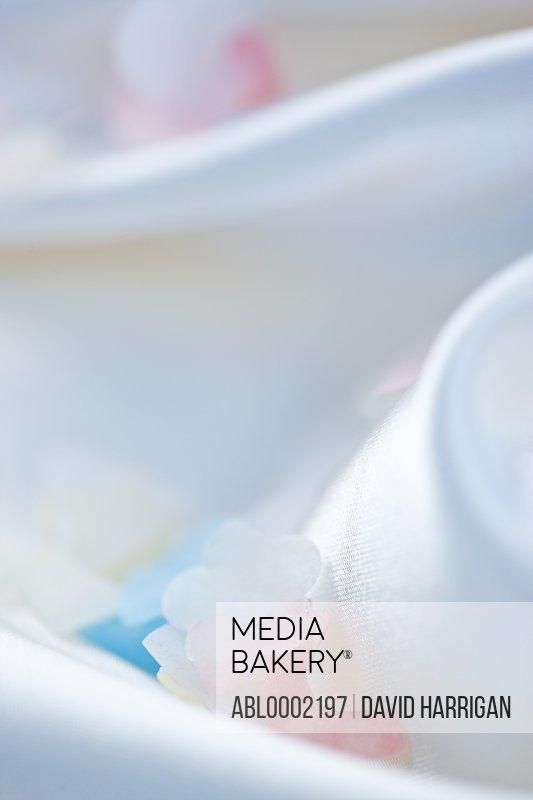 Pastel Colored Confetti on White Silk