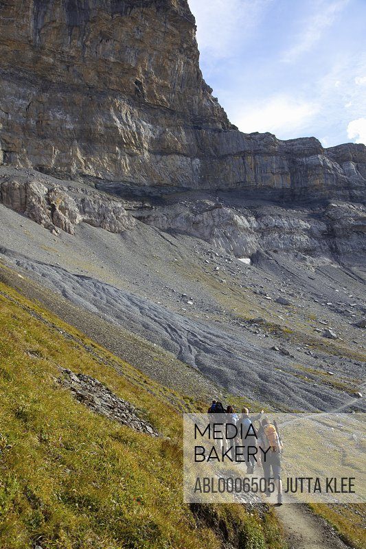 Friends Walking Eiger Trail in Bernese Oberland