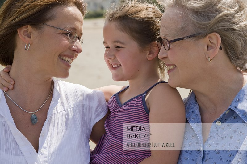 Close up of grandmother, mother and granddaughter smiling