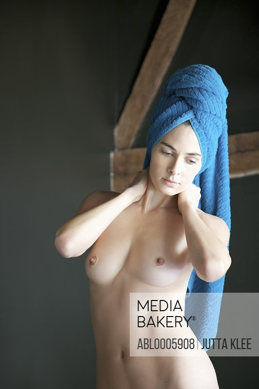Portrait of a nude woman with towel wrapped over head
