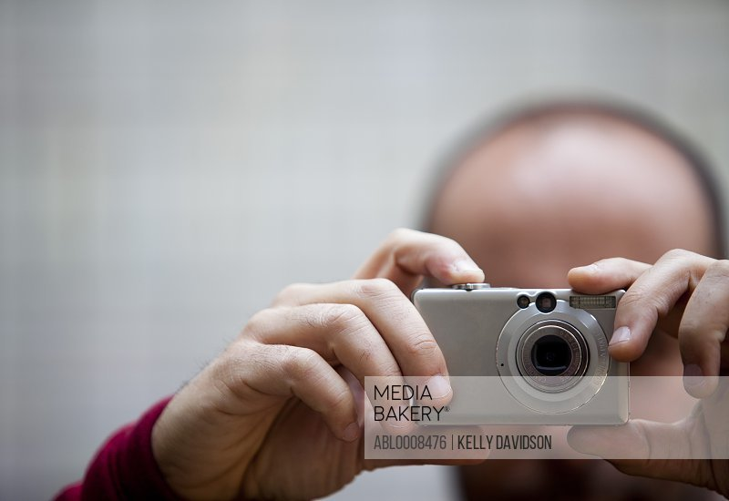 Man Taking a Photograph, Close-up View
