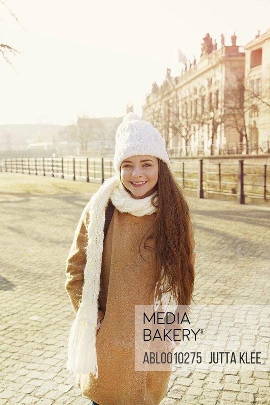 Teenage Girl Wearing Wool Hat and Scarf Smiling, Berlin, Germany