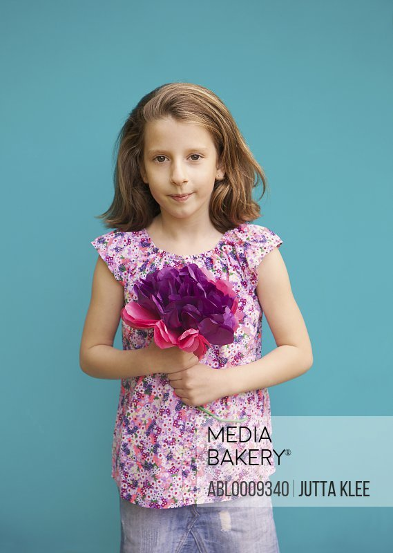 Girl Holding Bouquet of Paper Flowers