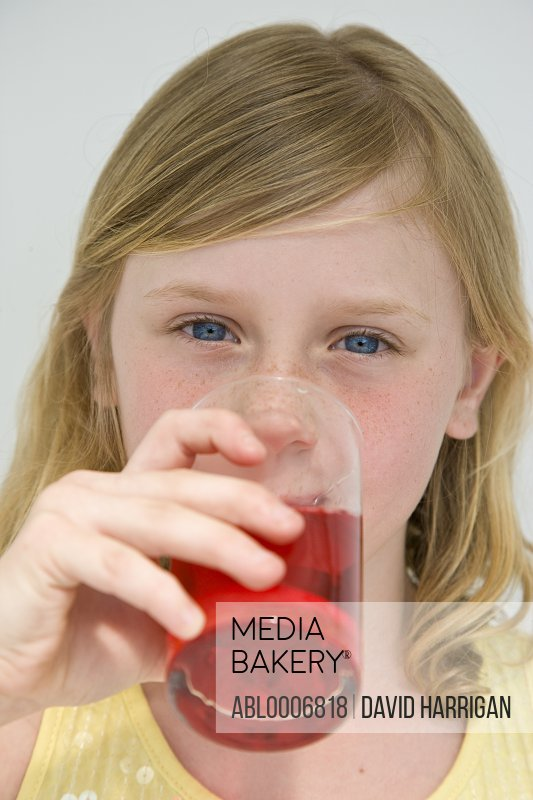 Young Girl Drinking Cranberry Juice