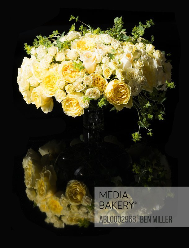 Bouquet of Yellow Roses and Persian Buttercup Flowers in a Vase