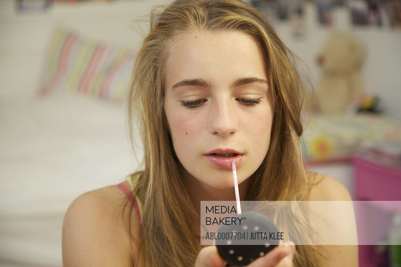 Teenage Girl Applying Lip Gloss