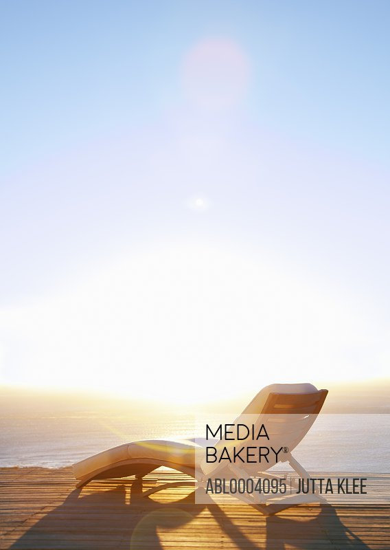 Sun Lounger on Deck at Sunset