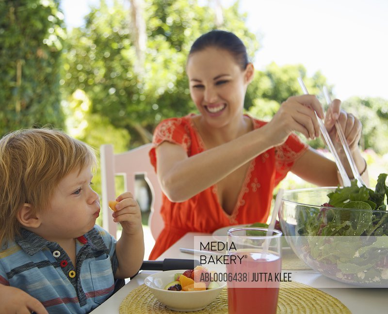 Woman and Child Eating Outside