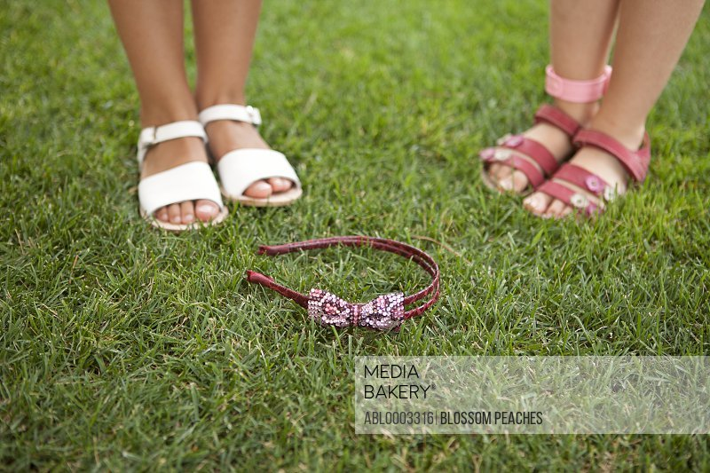 Young Girls Feet on Grass with Headband