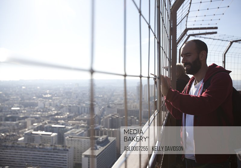 Man Looking Out from Observation Deck of Eiffel Tower