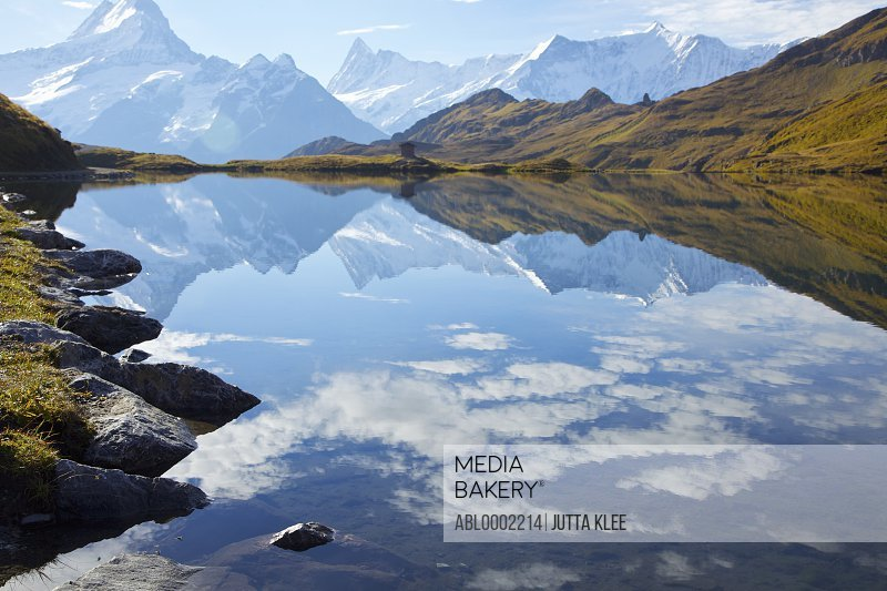 Lake Bachalpsee and Bernese Alps with Clouds Reflecting in Water