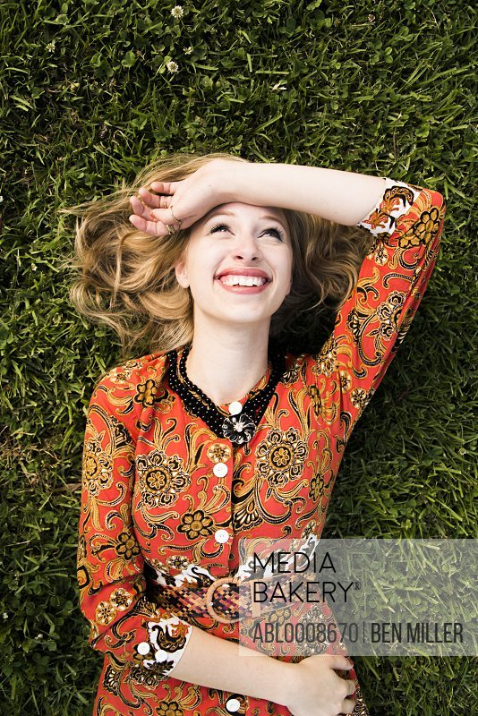 Smiling Woman Lying on Lawn