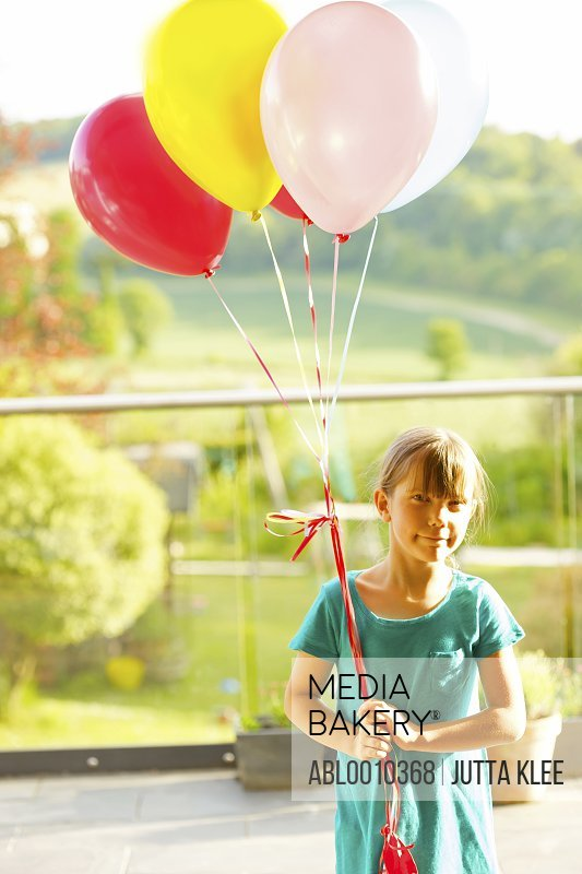 Young Girl (6-7 years) Holding Balloons