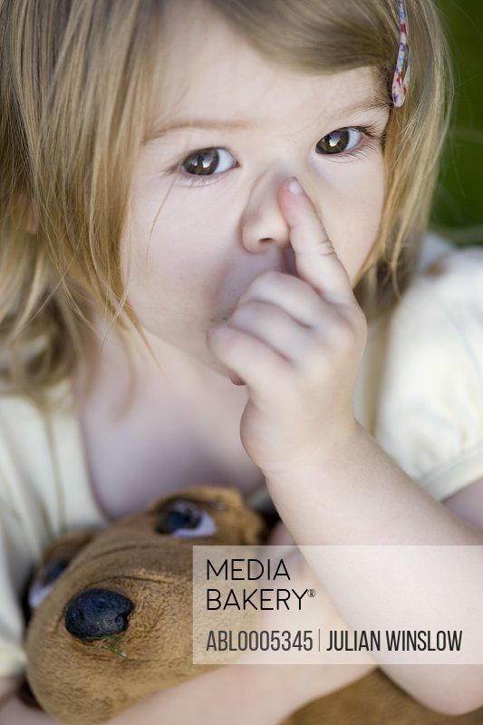 Girl Sucking Finger Holding Stuffed Toy