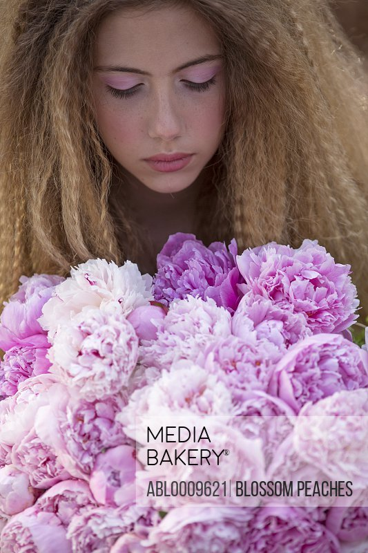 Girl Holding Bouquet of Pink Peonies, Close-up View