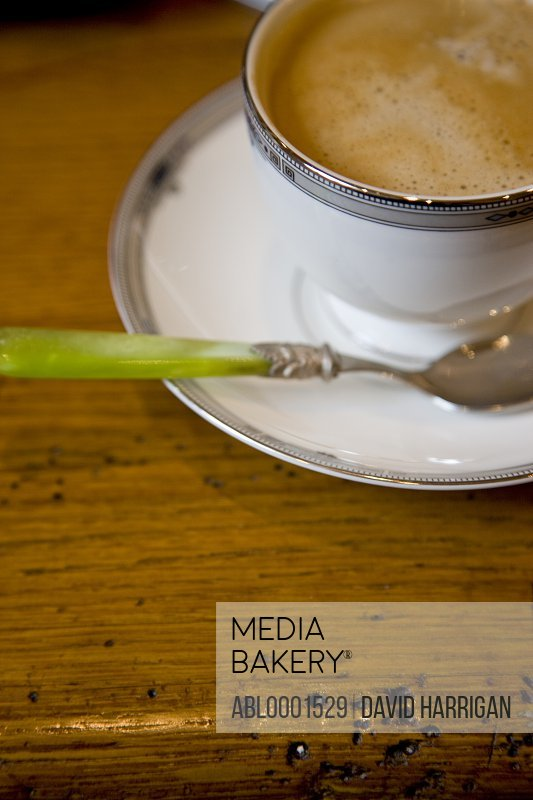 Close up of a cup of coffee on a wooden table