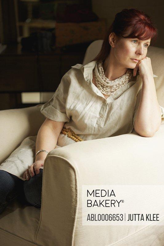 Woman Sitting on Armchair
