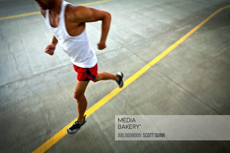 Man Running on Urban Road