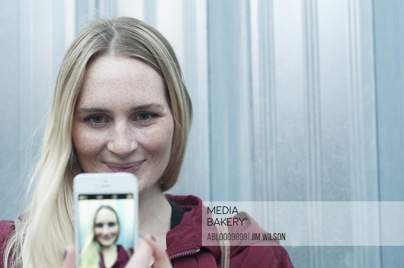 Woman Holding Smartphone with Self Portrait