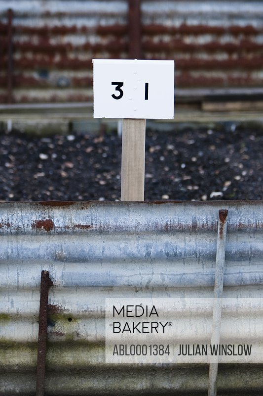 Rusty corrugated metal and number 31 tag