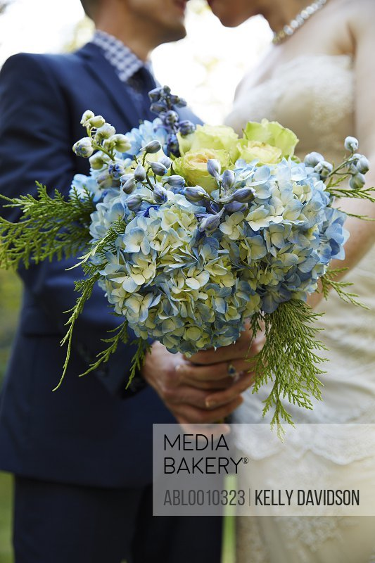 Bride and Groom Holding Bridal Bouquet of Hydrangeas
