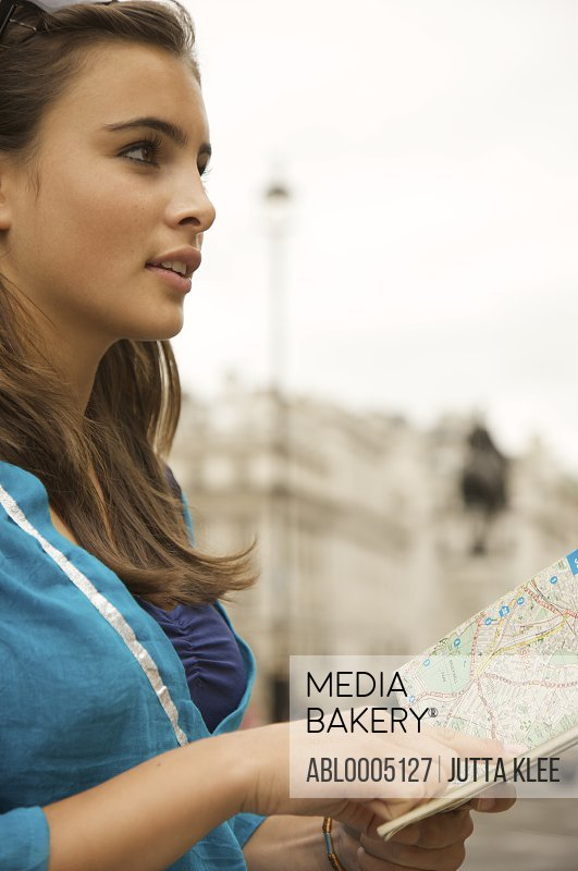 Teenaged girl holding a city map