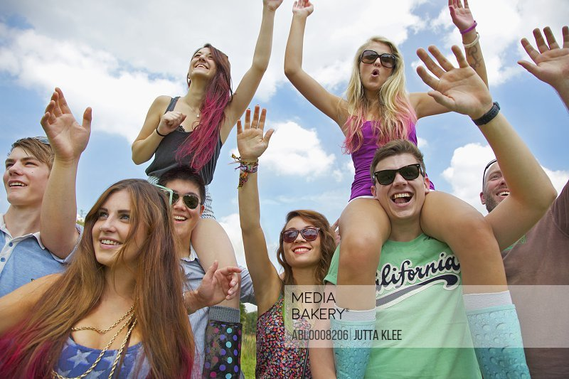 Group of Teenagers Cheering at Music Festival