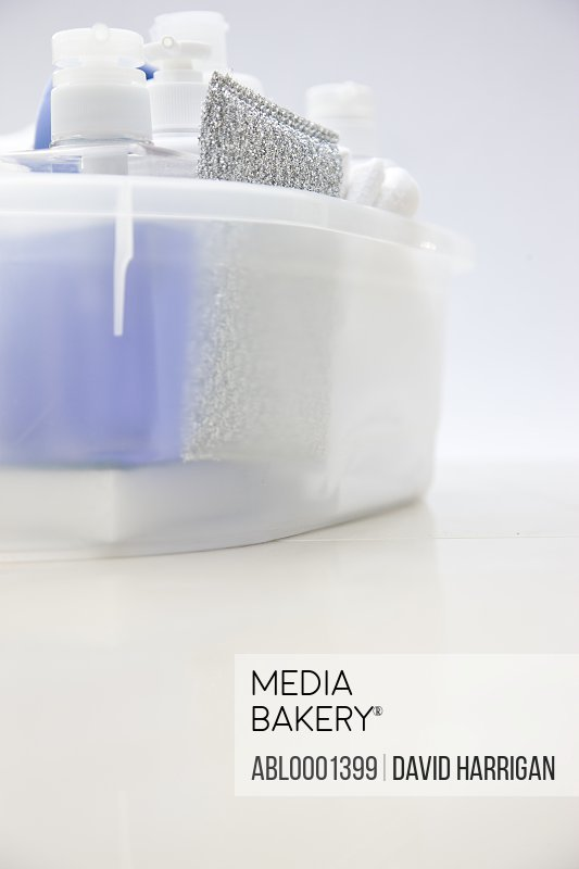 Close up of a cleaning caddy filled with cleaning products