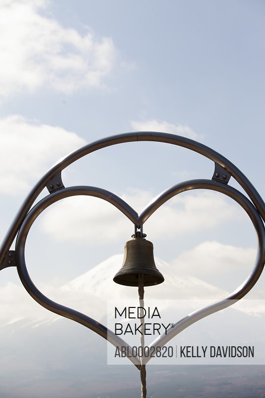 Heart Shaped Structure with Hanging Bell, Mount Fuji in Background
