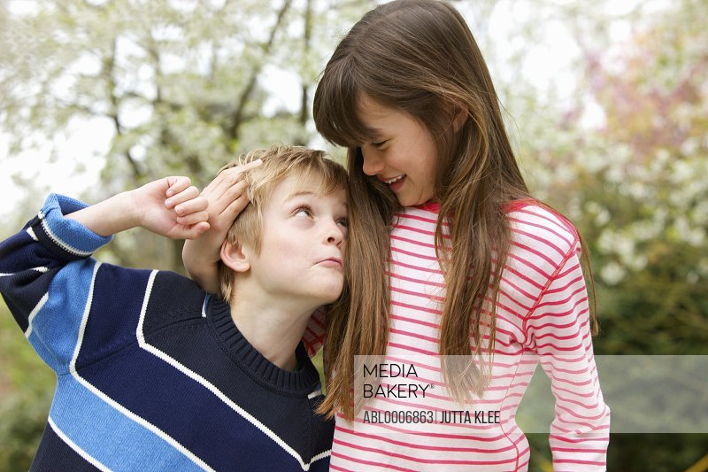 Boy and Girl Messing Around Outdoors