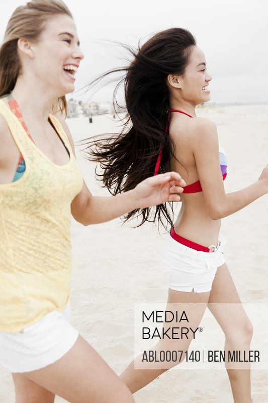 Teenage Girls Running on Beach