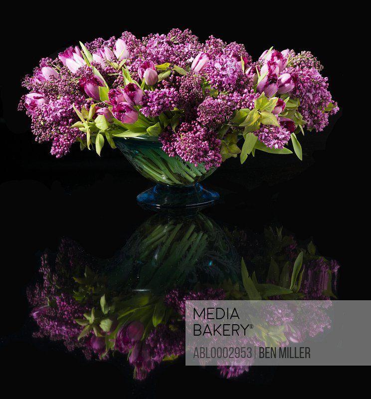 Bouquet of Pink Tulips and Lilac Flowers in a Vase