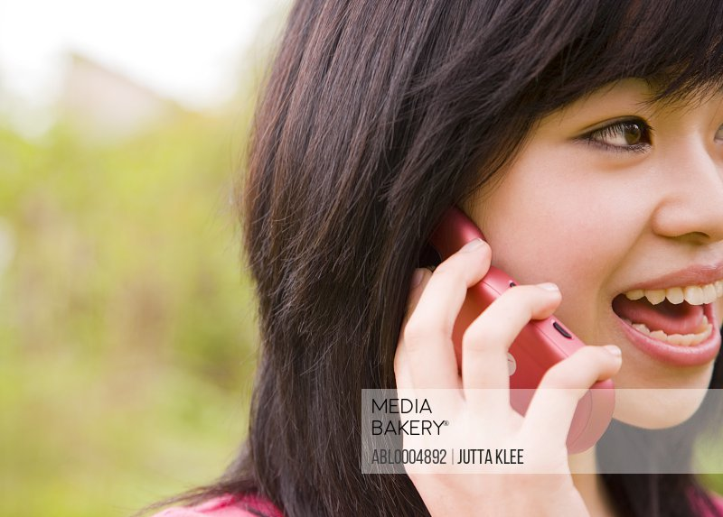 Close up of young teenaged girl talking on a cell phone