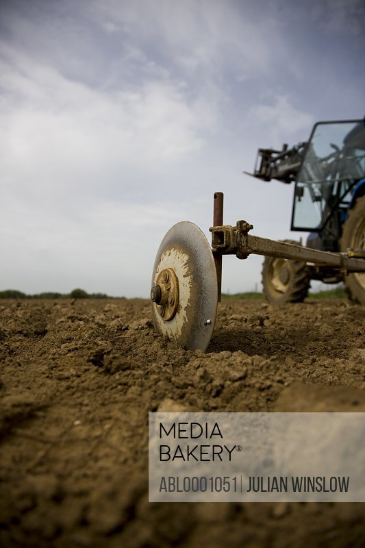 Agricultural field with tractor