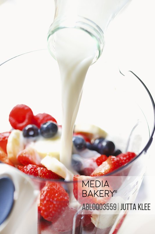 Milk being Poured over Mixed Fruit