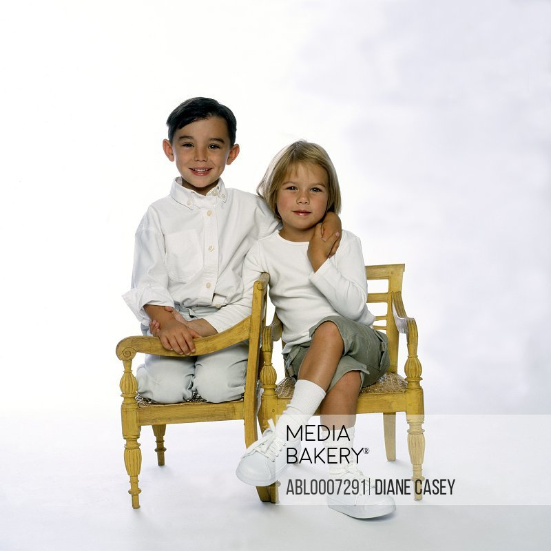 Boy and Girl Sitting and Holding Hands