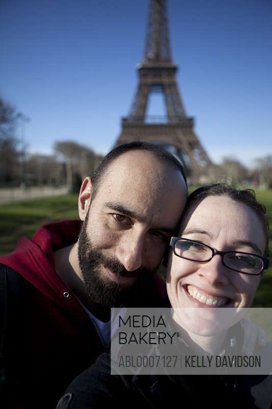 Smiling Couple in front of the Eiffel Tower