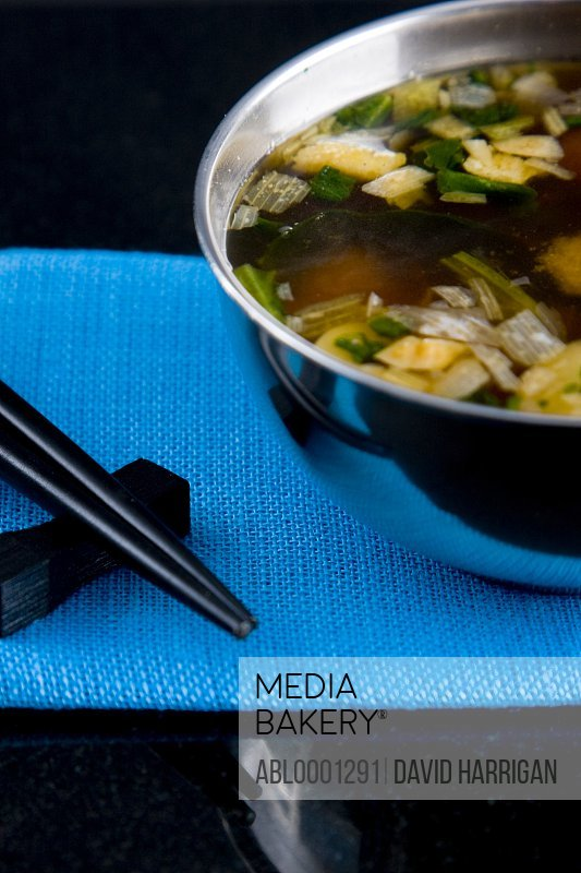 Close up of a place setting with a serving of miso soup