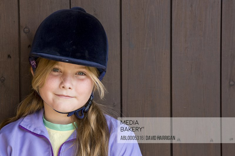 Portrait of a girl wearing a riding hat
