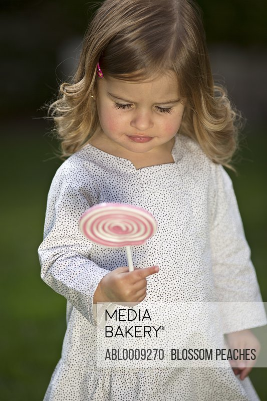 Young Girl Holding Lollipop