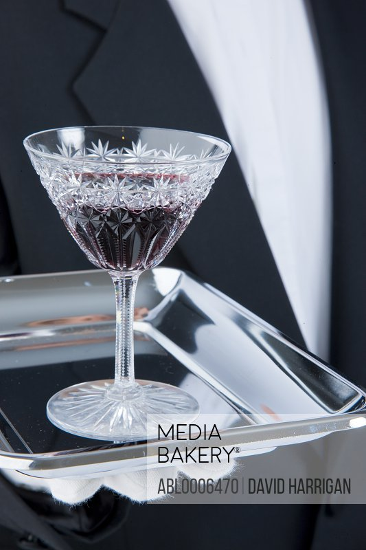 Waiter Holding Tray with Glass of Port
