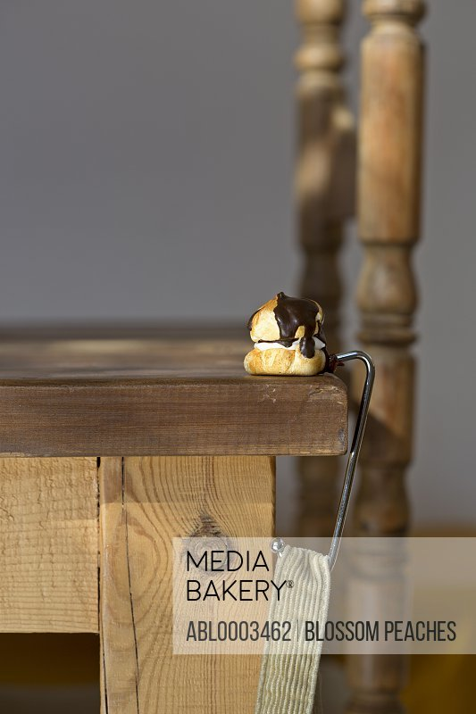Cream Puff on Wood Table with Purse Hanger Holder
