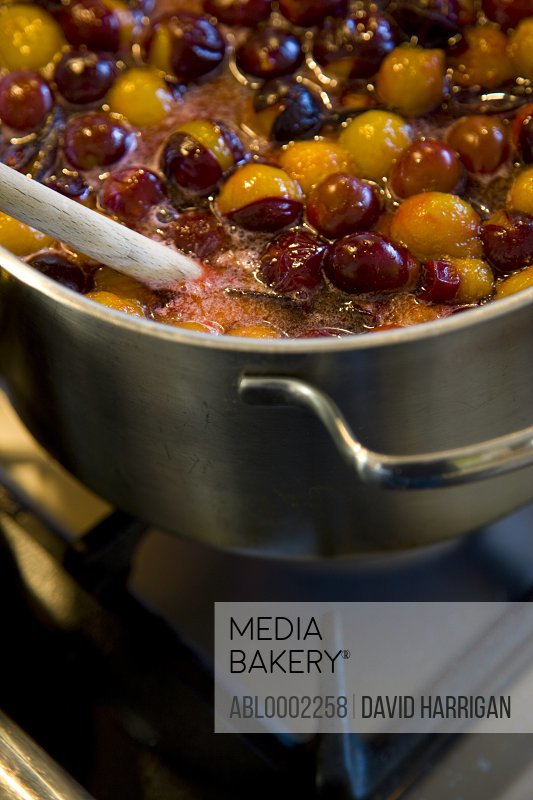 Damson Plums Simmering in a Pan on the Stove - Close-up view