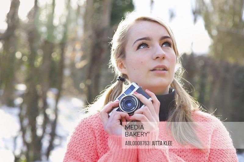 Teenage Girl Holding Camera
