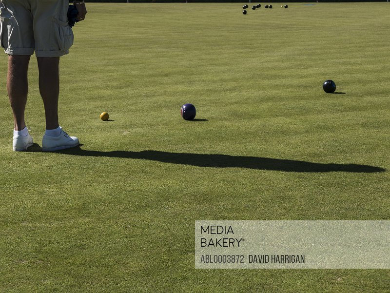 Man Playing Flat Lawn Bowls, Low section