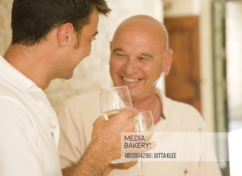 Father and son drinking wine