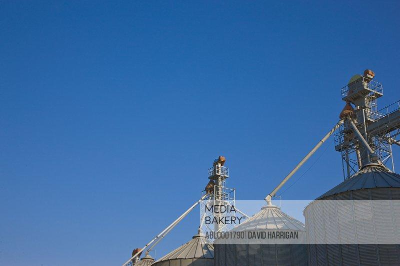 Grain silos against blue sky