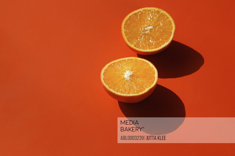 Halved Orange on Orange Background