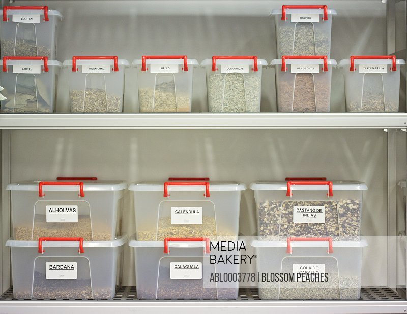 Labeled Plastic Containers on Shelves